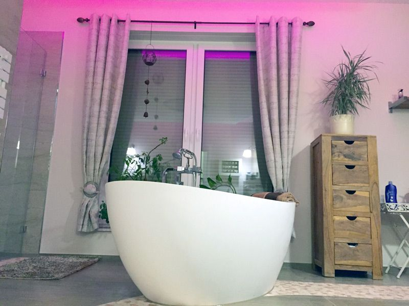 An elegant and amazing bathroom that features a Badeloft