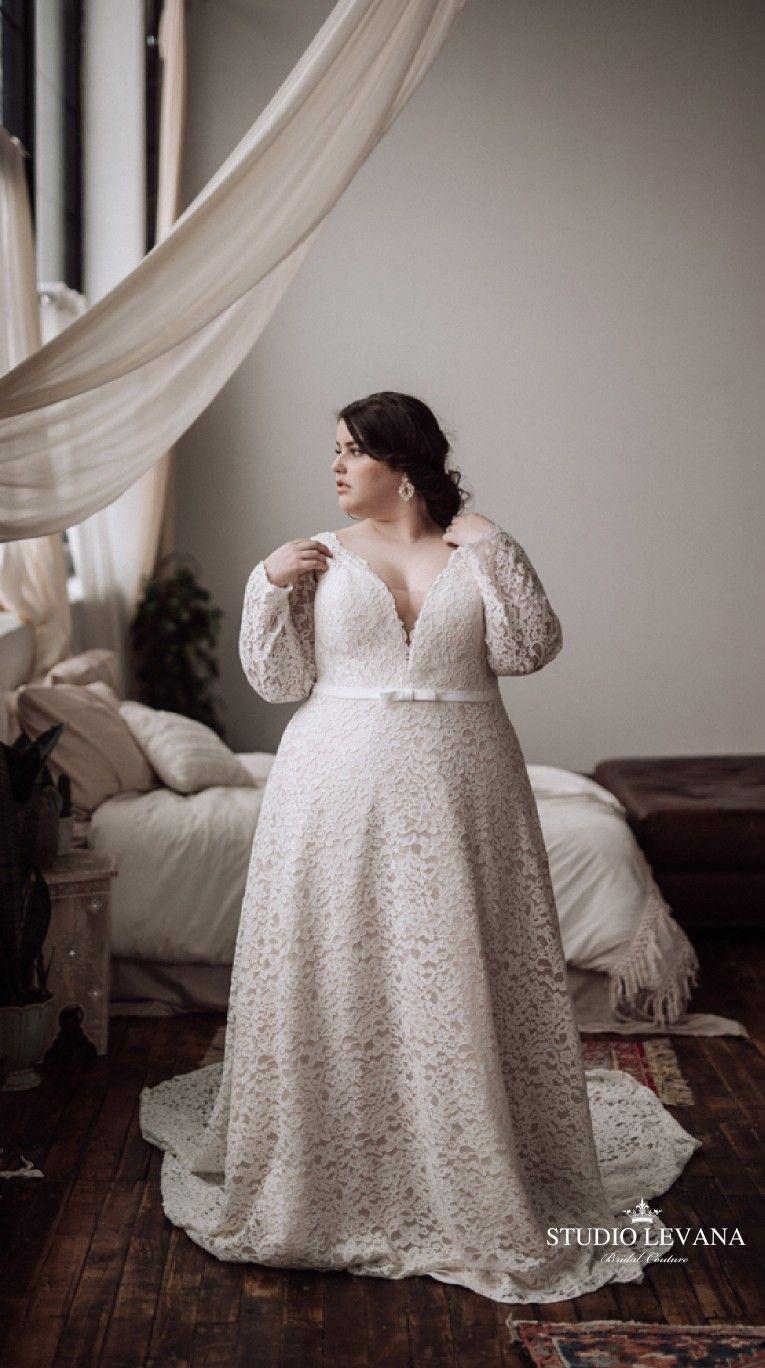 Beautiful Plus Size Bride Wearing Curvy Wedding Dress With Deep V