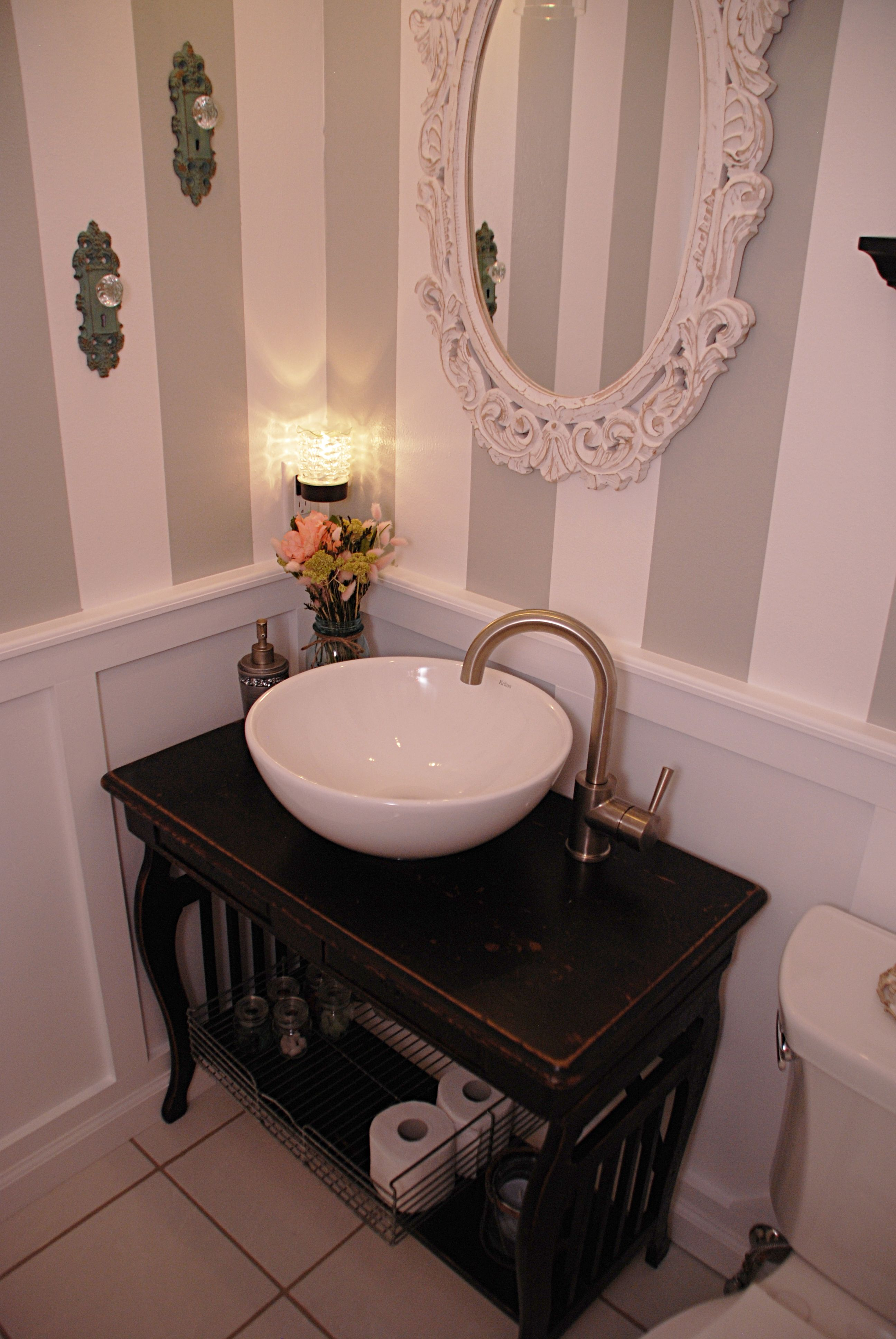 bath the vanity is an old antique desk they turned into a