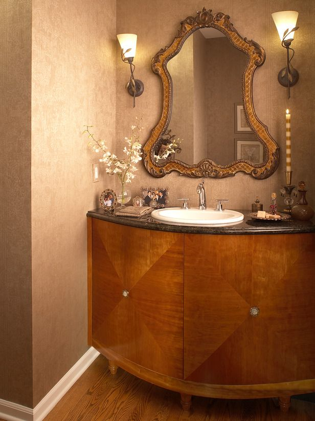 An Elegant Custom Vanity Is Combined With An Old World Mirror Rice Paper Walls And Jewelry Inspired Hardware Traditional Bathroom Bathroom Vanity