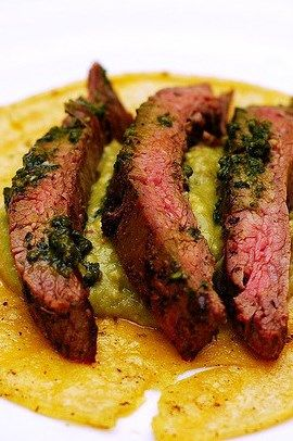 Flank steak over guacamole and corn tortillas - delicious dinner or even breakfast (with an egg on top!)