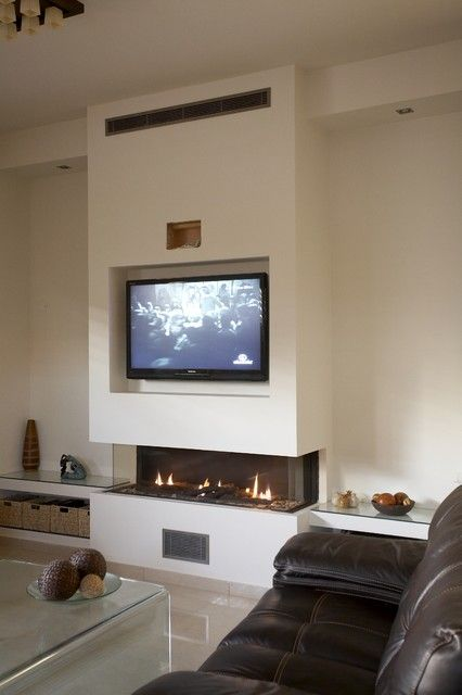a long gas fireplace   long, low three sided gas fireplace with ...