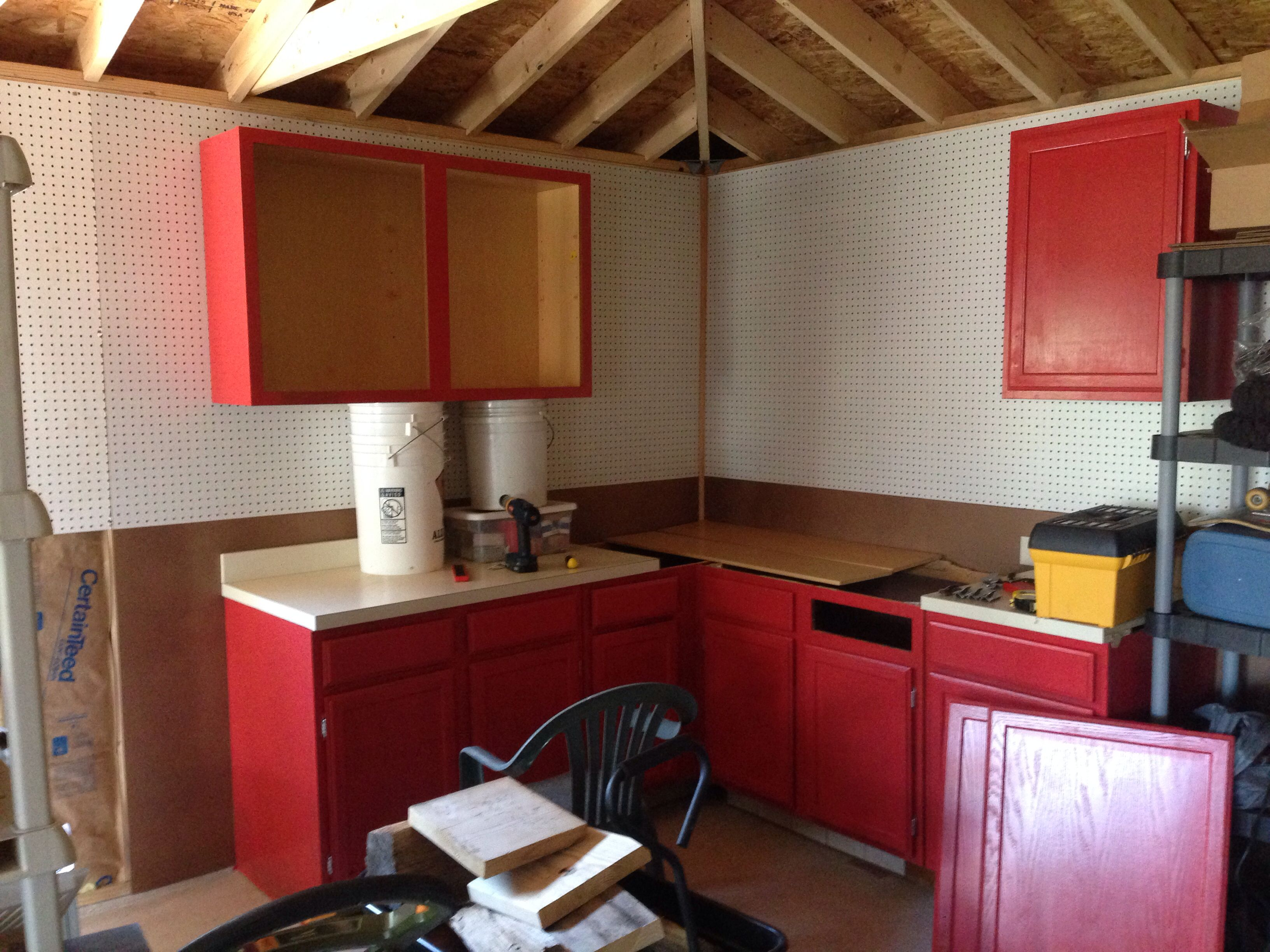 Hanging the wall mounted cabinets.   Kitchen cabinets ...