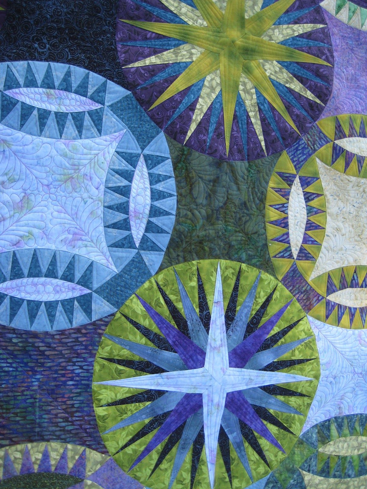 """close up, """"Mariners in a Pickle"""" quilt by Esther at Threads on the Floor. Mariner's compass star and pickle dish blocks. The pattern was in Fons and Porter magazine, September/October 2008."""