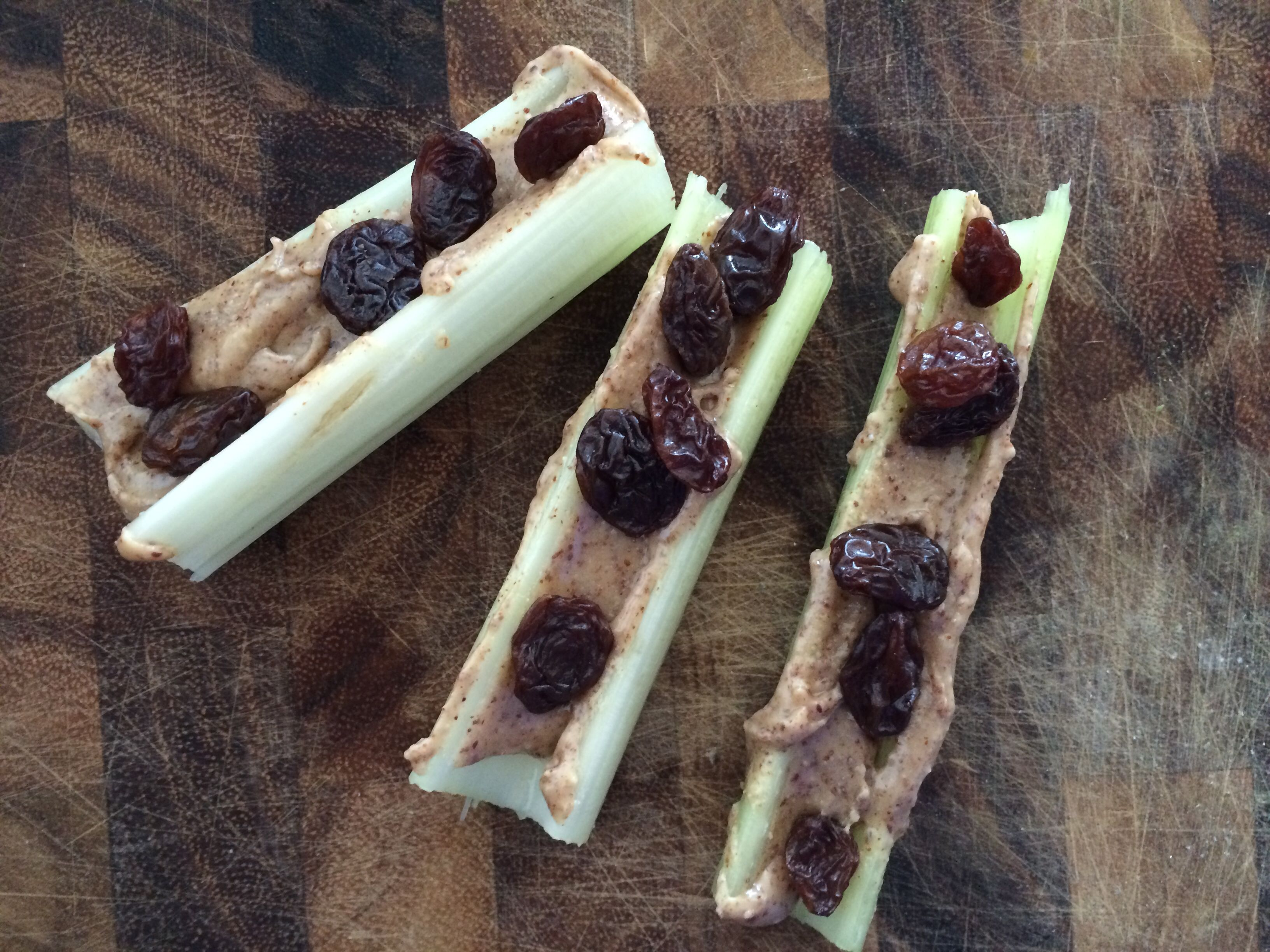 Ants on a log! Celery, almond butter & Thompson raisins. Simple and delicious!