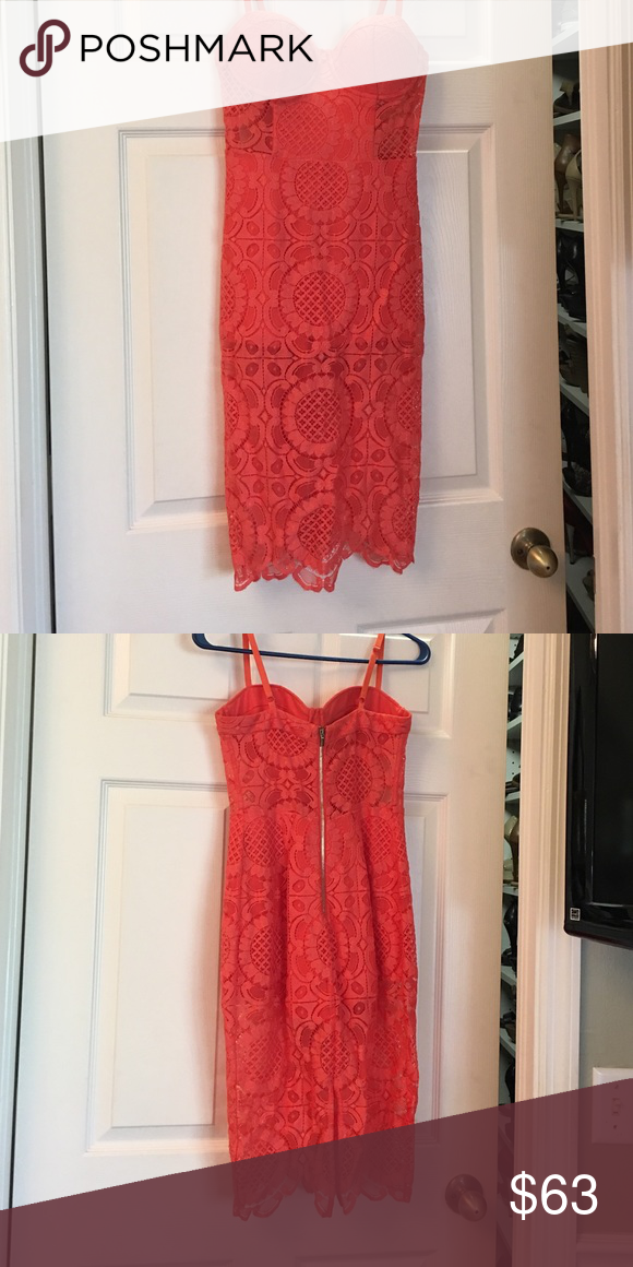 53e9718bc4ff Bebe coral lace dress Only worn once. Size 4 lace with shorts body suit  underneath. bebe Dresses Midi