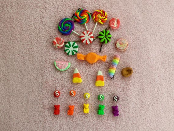 Twenty pieces of assorted candy hair clips mounted on snaps and bobby pins. Cute and fun clips to wear anywhere you want! Modeled after