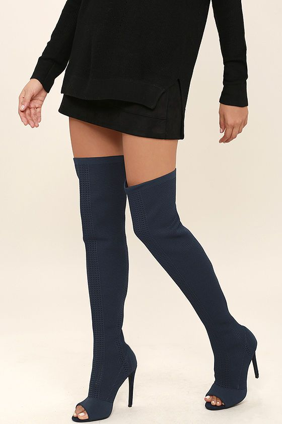 """If on-trend heels give you life, then you won't be able to resist the Vice Navy Knit Peep-Toe Thigh High Boots! Thick and stretchy pierced knit starts at a peep-toe upper, and climbs to a sexy 25"""" shaft. Collar has a 17"""" circumference relaxed."""