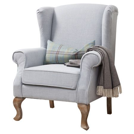 Add an elegant touch to your study or living room with this linen upholstered wing back armchair, featuring scroll arms and carved oak legs. Team with a soft...