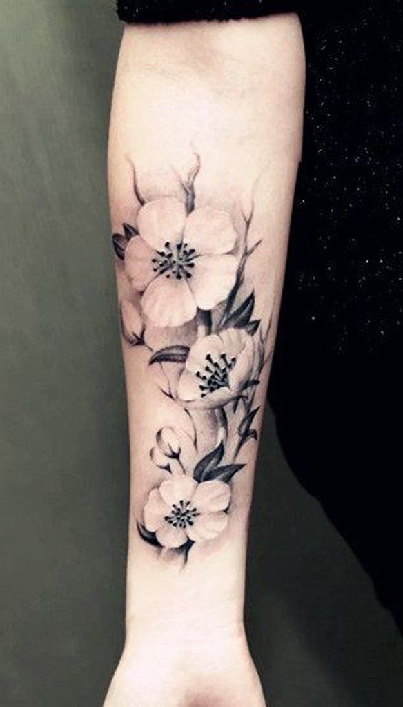 Black Flower Tattoos Wrist: Black Floral Wrist Tattoo - MyBodiArt.com