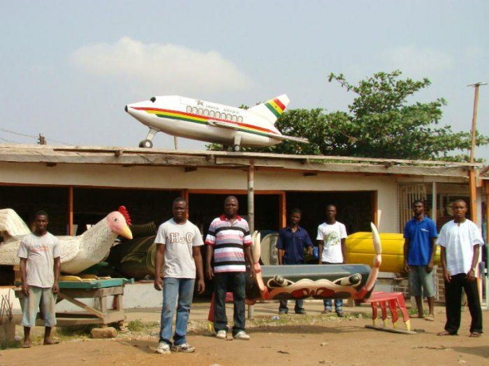 Funerals in Ghana: The Kane Kwei Workshop in Accra, with a selection of fantasy coffins. Photo by Jean-Michel Rousset via Wikimedia.
