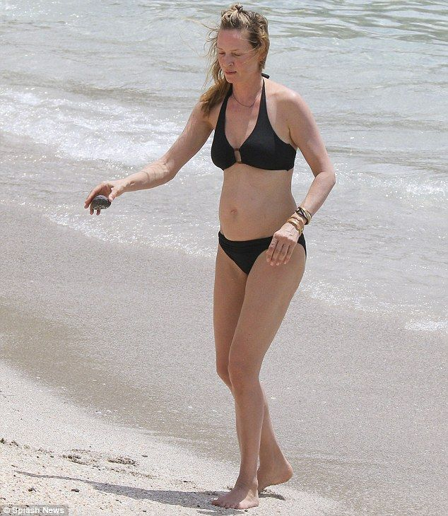 How does she do it?: Uma looked younger than her 44 years as she soaked up the sun...