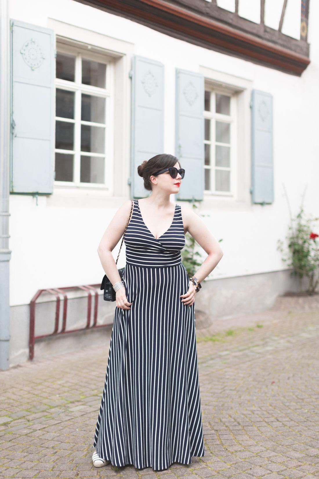 0858c2d088e12 French blogger Pauline in the full skirt maxi dress. This black and white  stripe dress