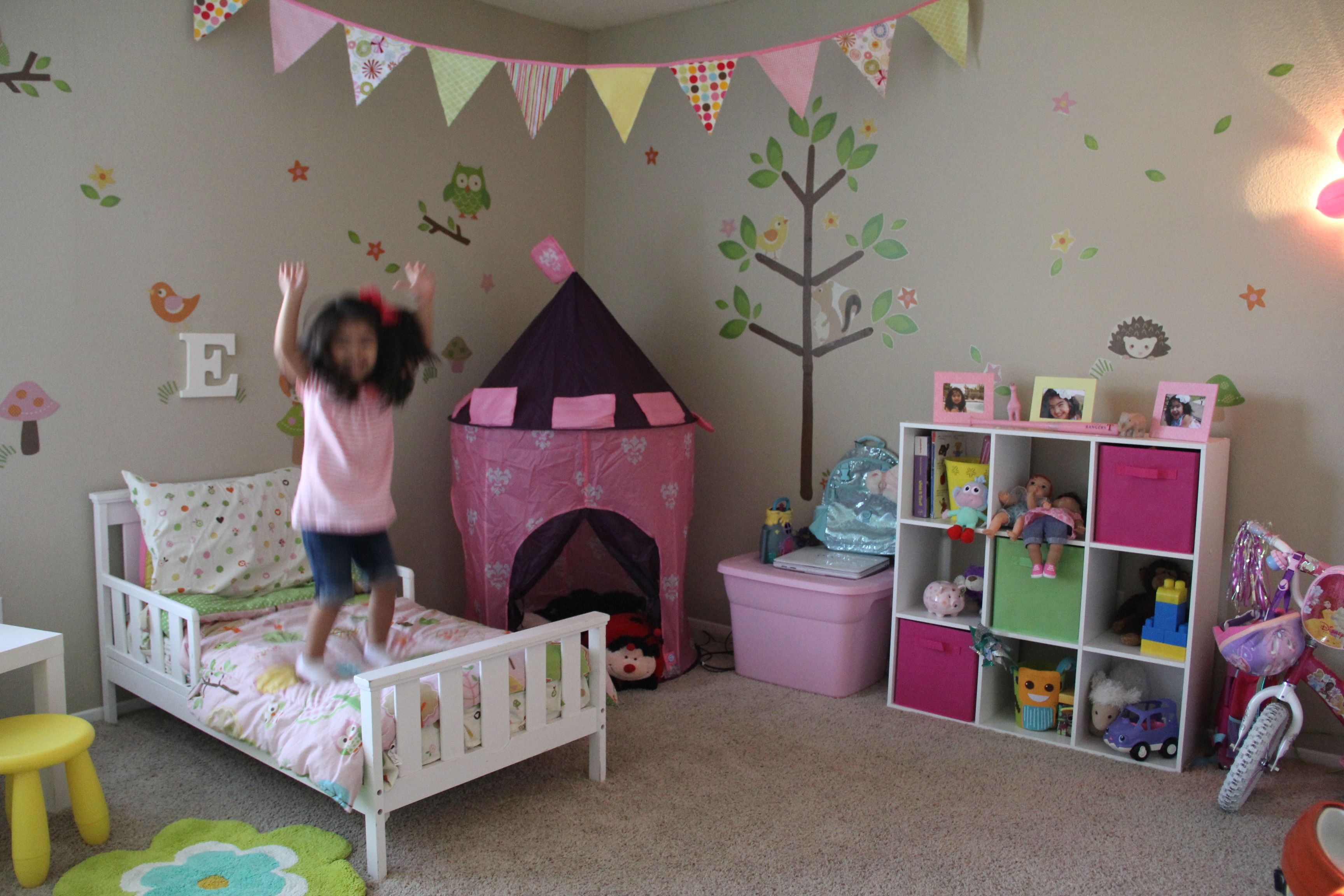 Excited about her new room!