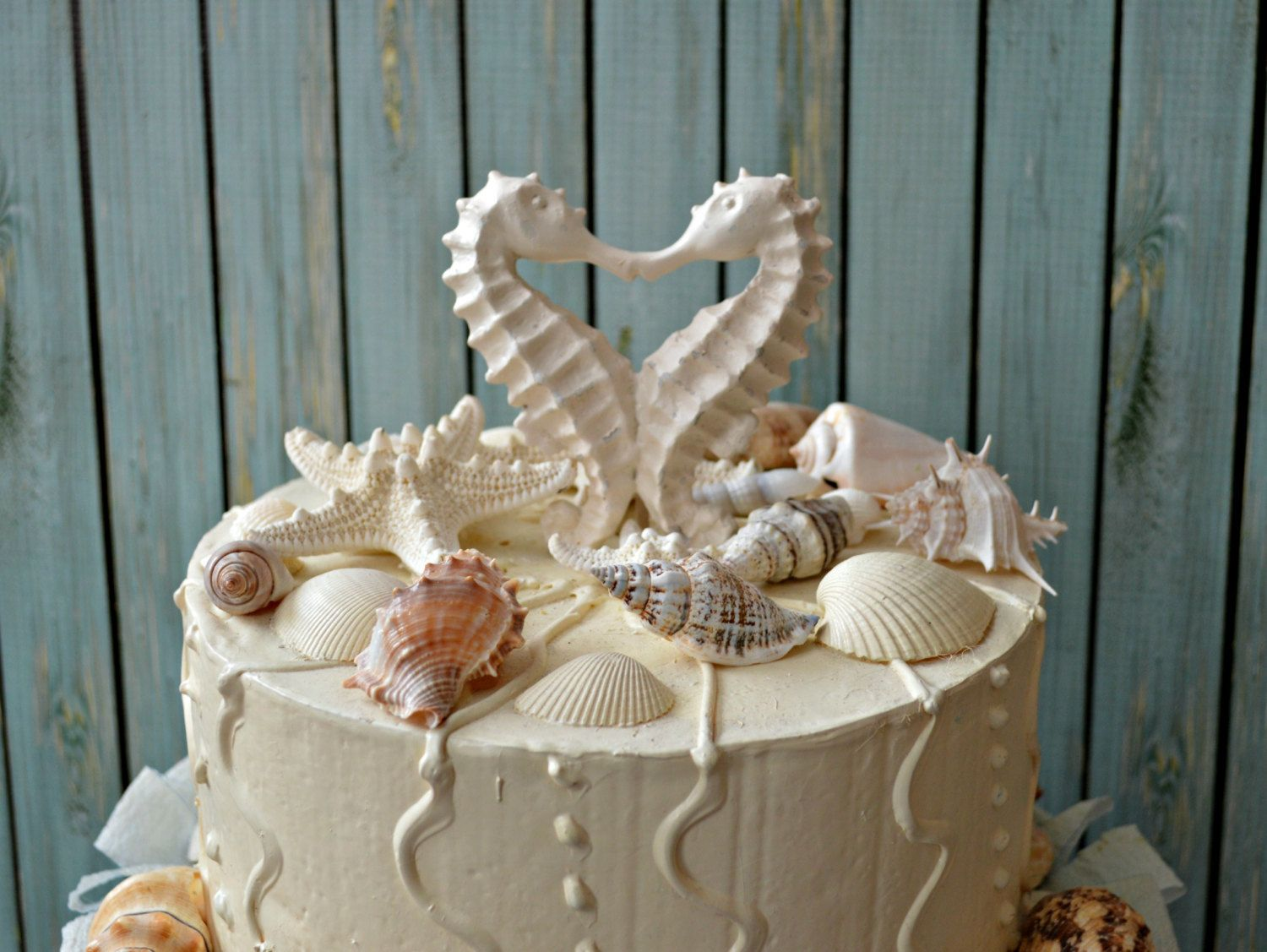 Image result for bride and groom beach cake toppers