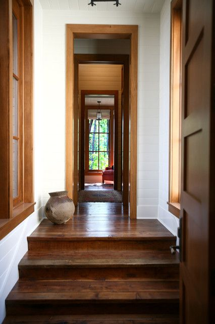 Stained Floor And Doors Trim And White Baseboards