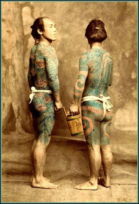 ANSWER : The old wet-plate collodian negatives were not very sensitive to the color of the real tattoos on the skin, and they were barely visible on the prints. In fact, they were sometimes so hard to see that the colorists just made up their own designs as they went along, each one coloring the photo differently, using their imagination to guide them!