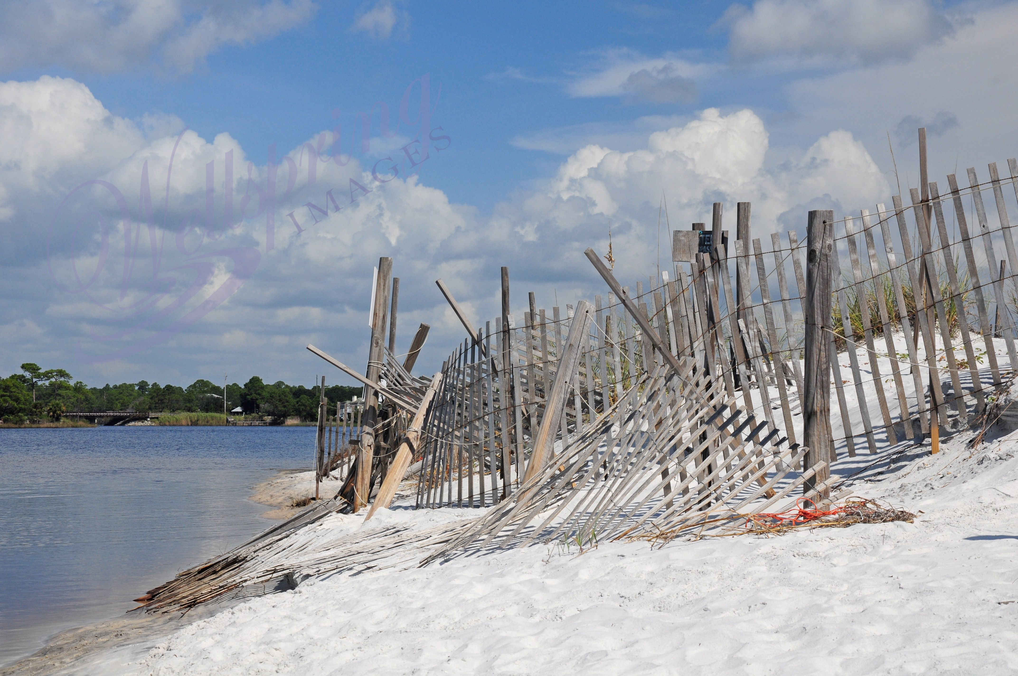 In need of repair, but still pretty,  I love the look of this old fence on the inlet beach.  Fluffy clouds never hurt either.