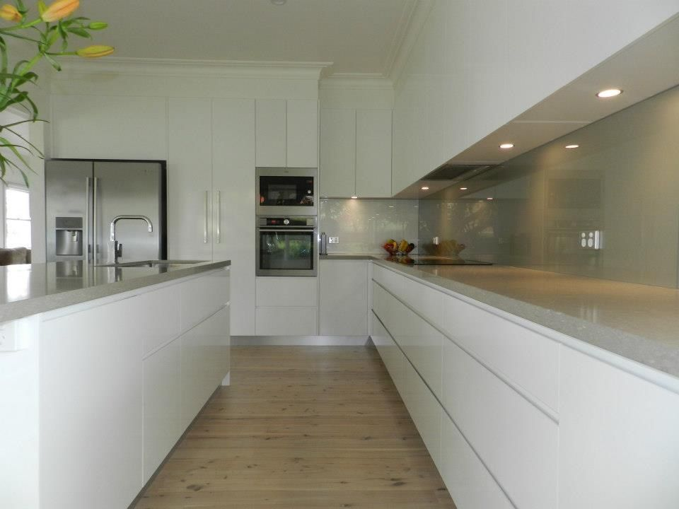 Long kitchen white units with pale grey worktop good balance favorite places spaces - White kitchen ideas that work ...