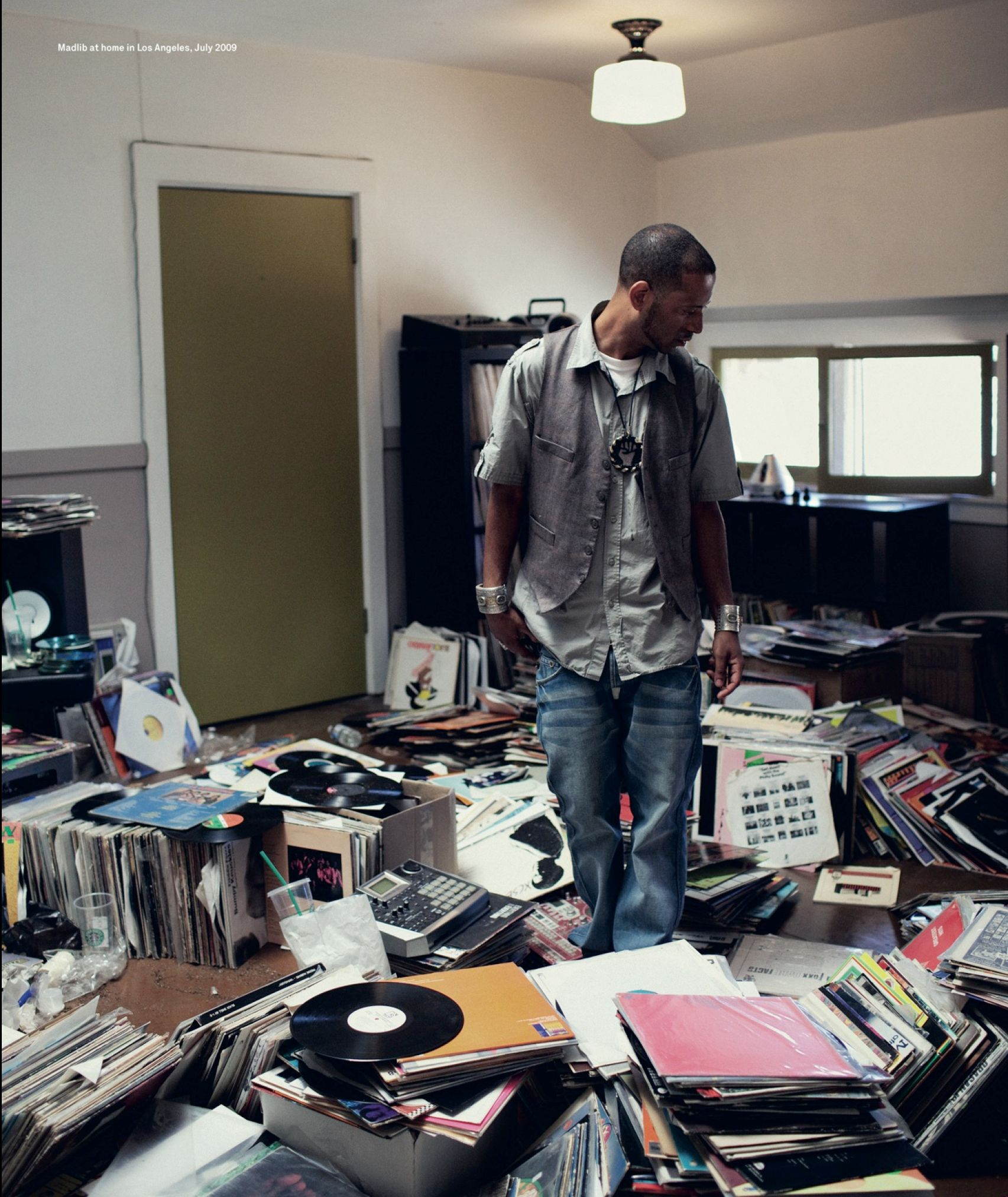 Madlib with his vinyl and MPC 4000 in the middle
