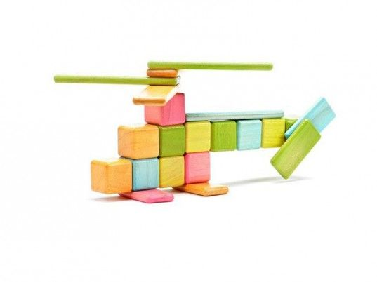 Magnetic building blocks.  Sustainably harvested Honduran hardwood.  Tegu.