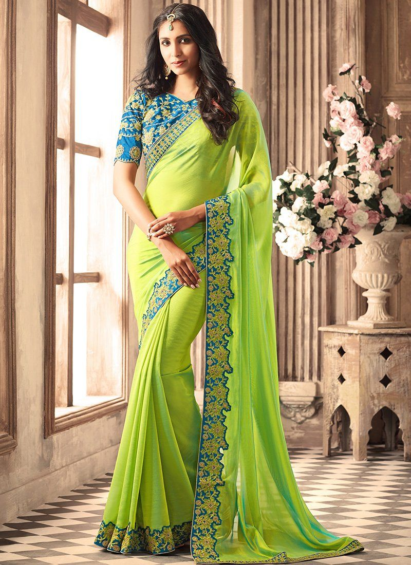 52ee03d1ac4e2c Light Green and Blue Embroidered Silk Saree features a beautiful silk saree.  Embroidery work is completed with zari