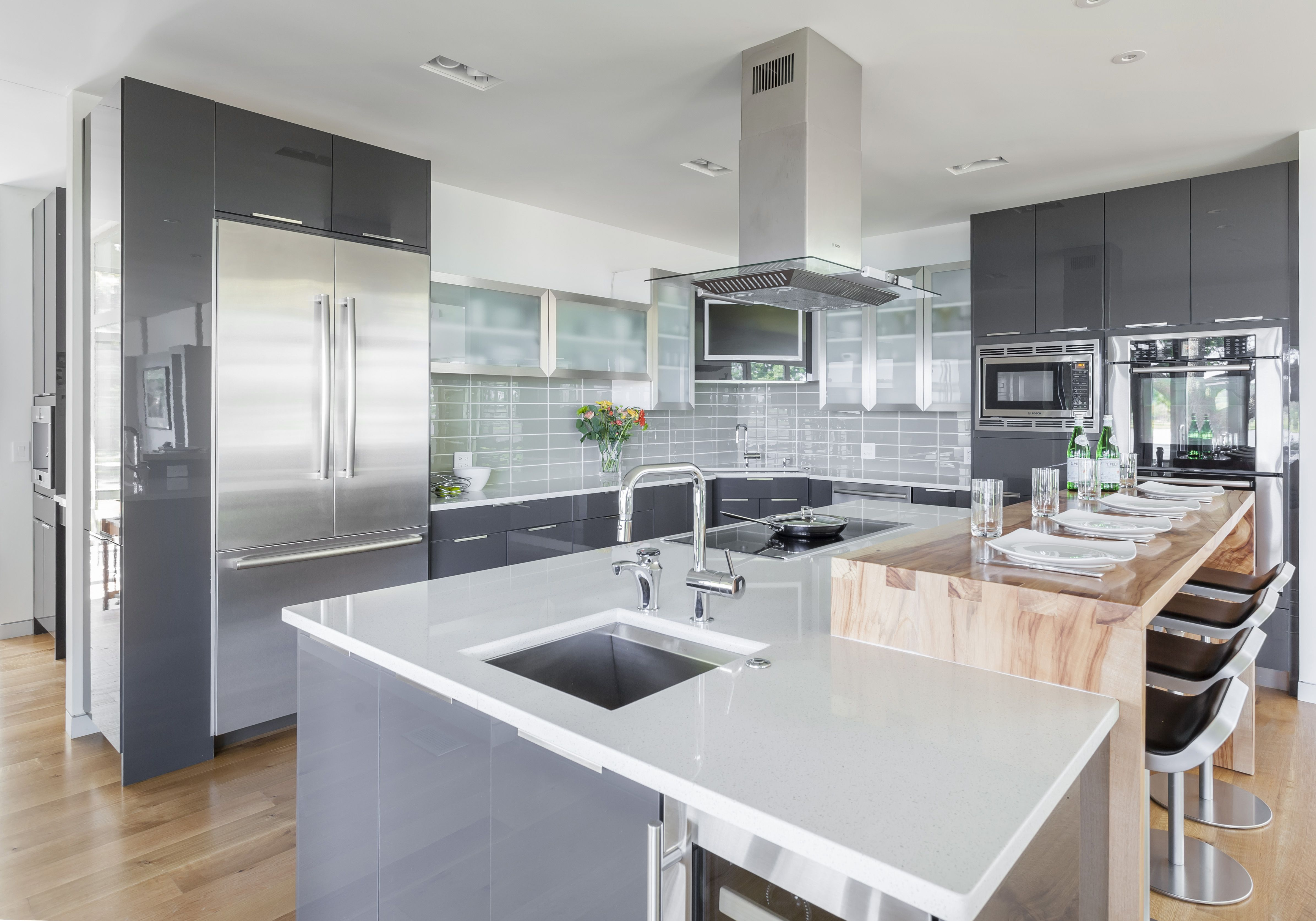 Elmwood Cabinetry, Bosch Appliances, Waterfall Wood Bar Top, Hand Washing  Sink