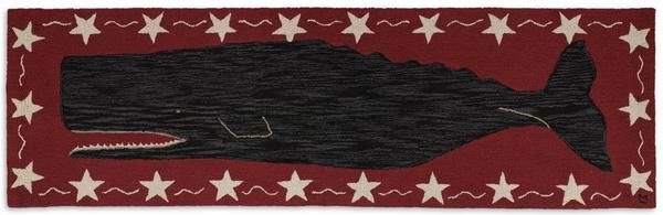 "This majestic whale is swimming through a ocean of deep crimson with stars in the border of this nautical themed rug. This runner is 30"" wide x 96"" long and was"