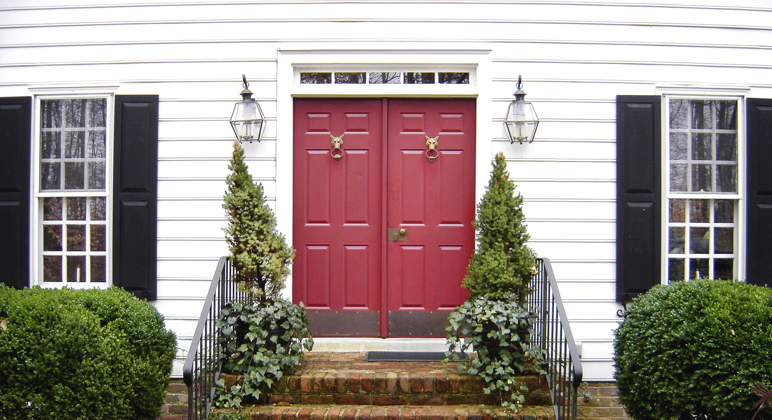 The Perfect Red Front Door This Colonial Style Home Features A Red Double Door White Siding And Black Shut White Siding Colonial Style Homes Colonial Style