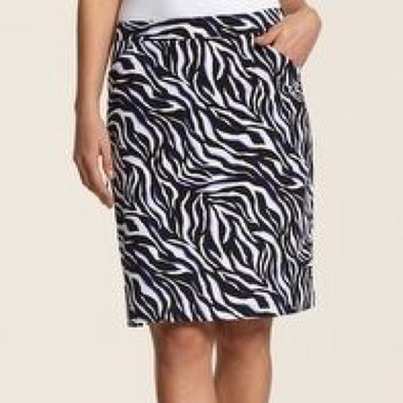"""SOLD IN BUNDLE Worn once.  Looks brand new.  Gorgeous expensive golf Skort.   So comfy! Side zip. Fully lined with shorts.  2 pockets. Side zip pocket. Black and white with purple accent. Waist flat 15"""" hips 18"""" length 18"""". Chico's sz 0 fits a small 4-6 best Chico's Skirts"""
