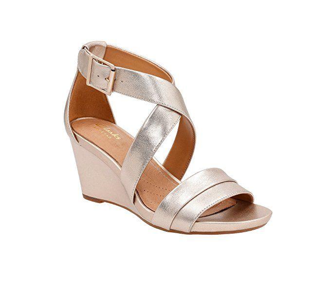 52417e1c3e0 Clarks Women s Acina Newport Gold Leather Sandal. Clarks Women s Acina  Newport Gold Leather Sandal Metallic Wedges ...