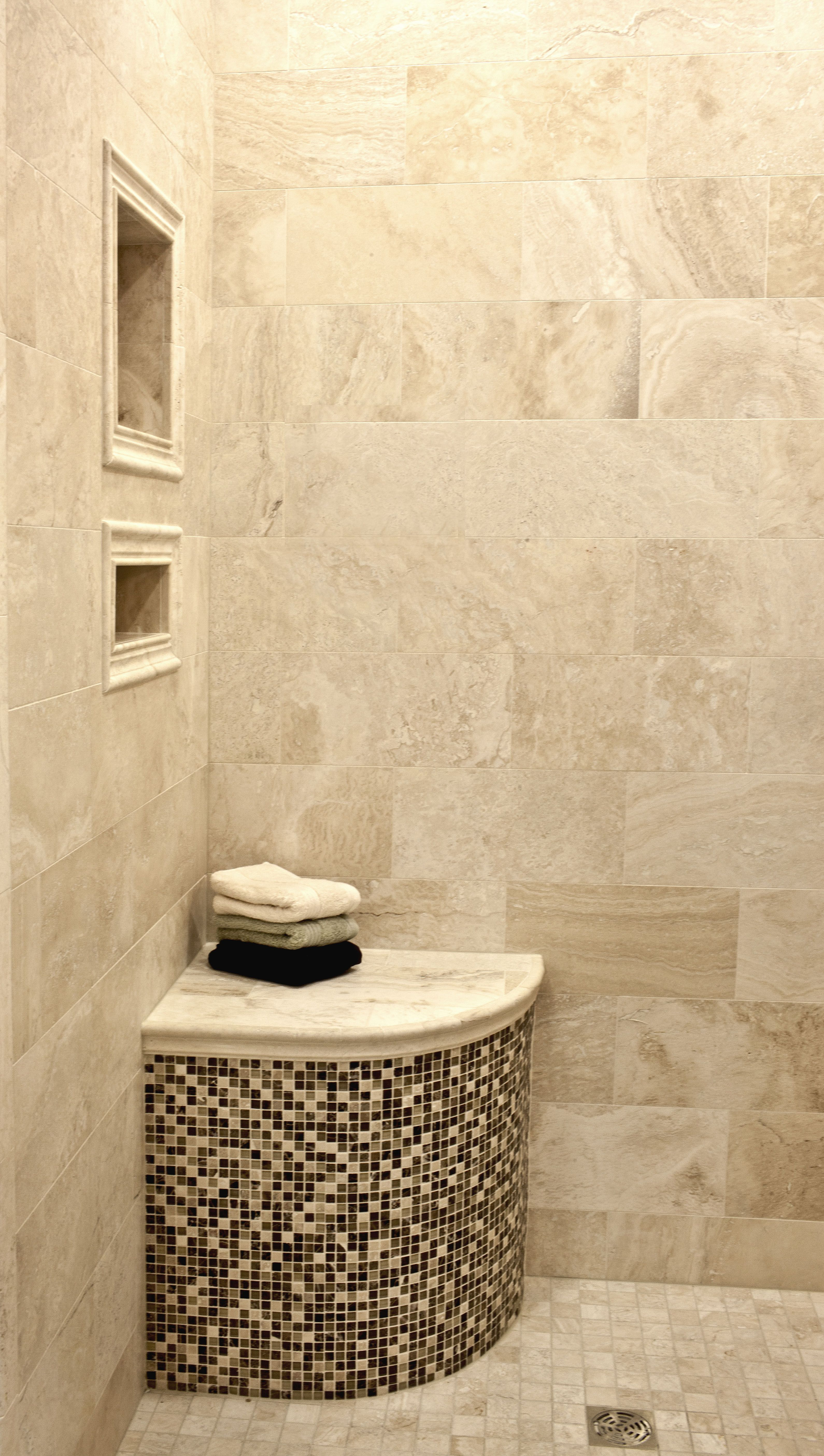 Like the idea of the seat in the shower tiled with the same