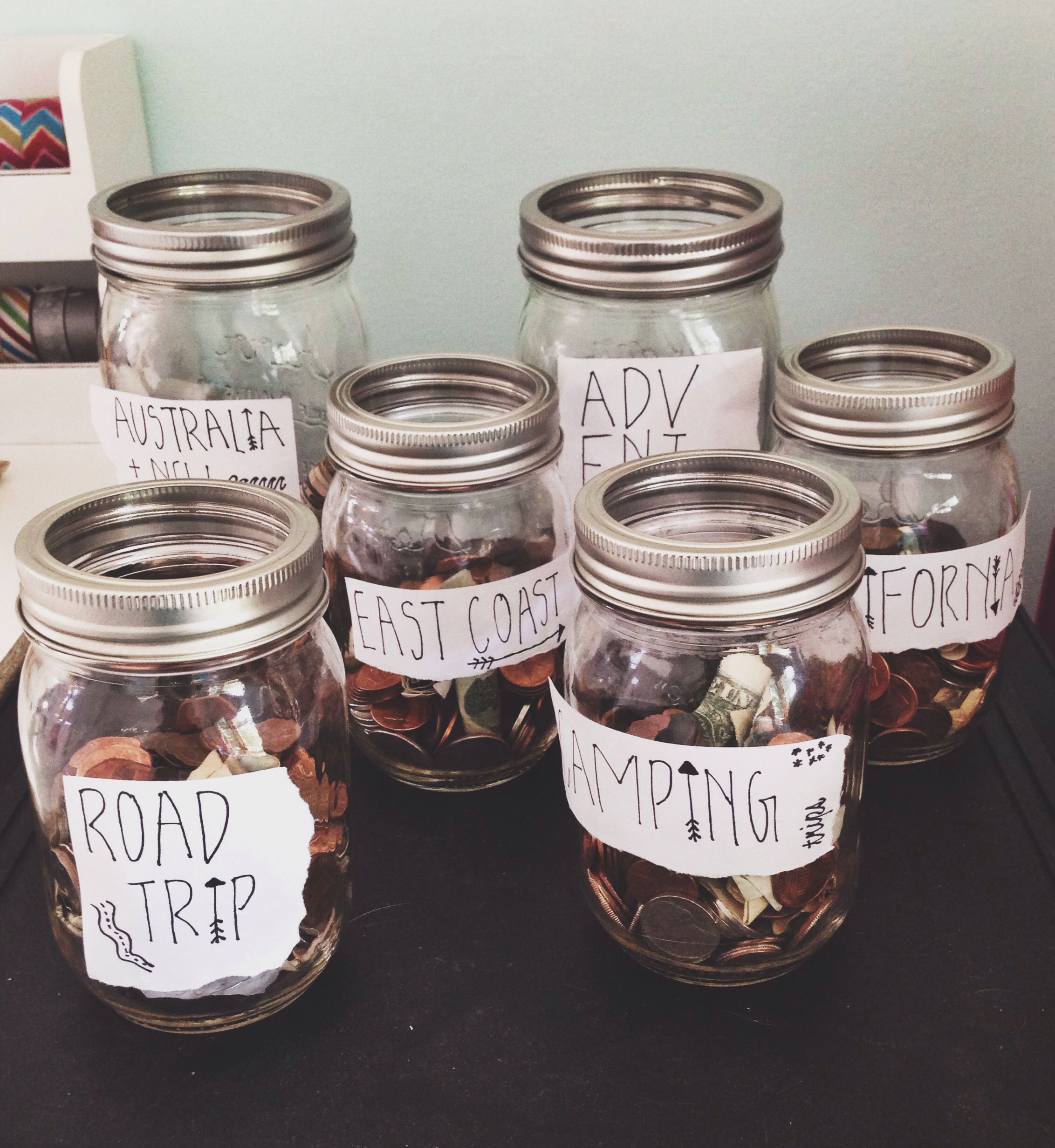 use mason jars & ripped paper as labels to save up for the travels