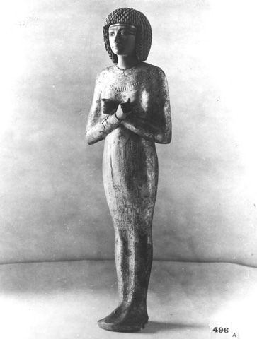 An ancient Egyptian female with her hands crossed over her stomach as a symbol of fertility. - The Griffith Institute Tutankhamun: Anatomy of an Excavation The Howard Carter Archives Photographs by Harry Burton