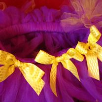Vikings, Lakers, LSU, Purple lovers, etc!    Item ships within 2 days of order!    FREE matching tutu ponytail holder, crochet headband or puff clip! Please specify in comments when you order.     Yards and yards of double-layer, purple tulle accented with yellow ends. Matching ribbon can be added at no additional cost. Handtied with double...