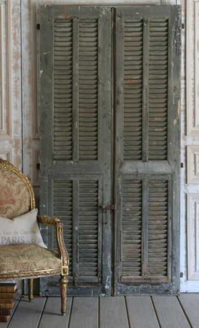 imagine antique shutters as an office or guest room door on casters so it  slides open from the middle. - I Want To Put Old Shutters In The Living Room! Where Can I Find