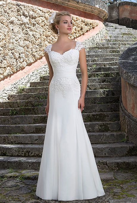 Sincerity Bridal. Venice lace cap sleeves draw the eye to the Queen ...