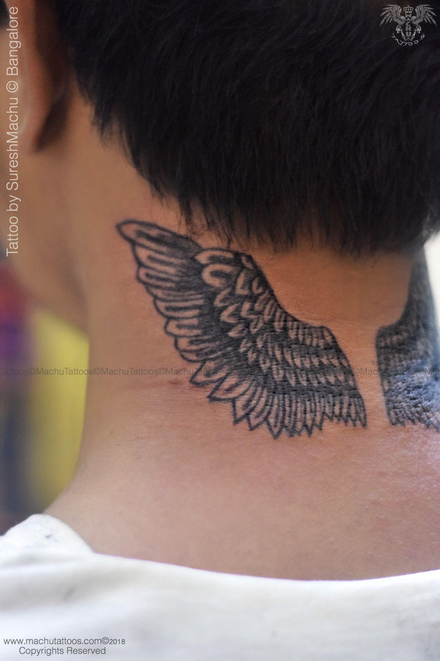 Justin biber back neck wings tattoo done by suresh machu