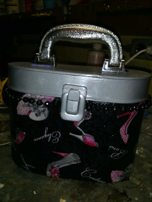 Decopouged the body and painted the top of the tin purse.