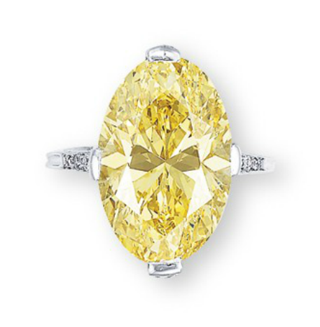 A SUPERB COLOURED DIAMOND AND DIAMOND RING, BY TIFFANY & CO. Set with an oval-shaped fancy vivid yellow diamond weighing 12.02 carats, to the pavé-set diamond gallery and quarter-hoop, mounted in platinum