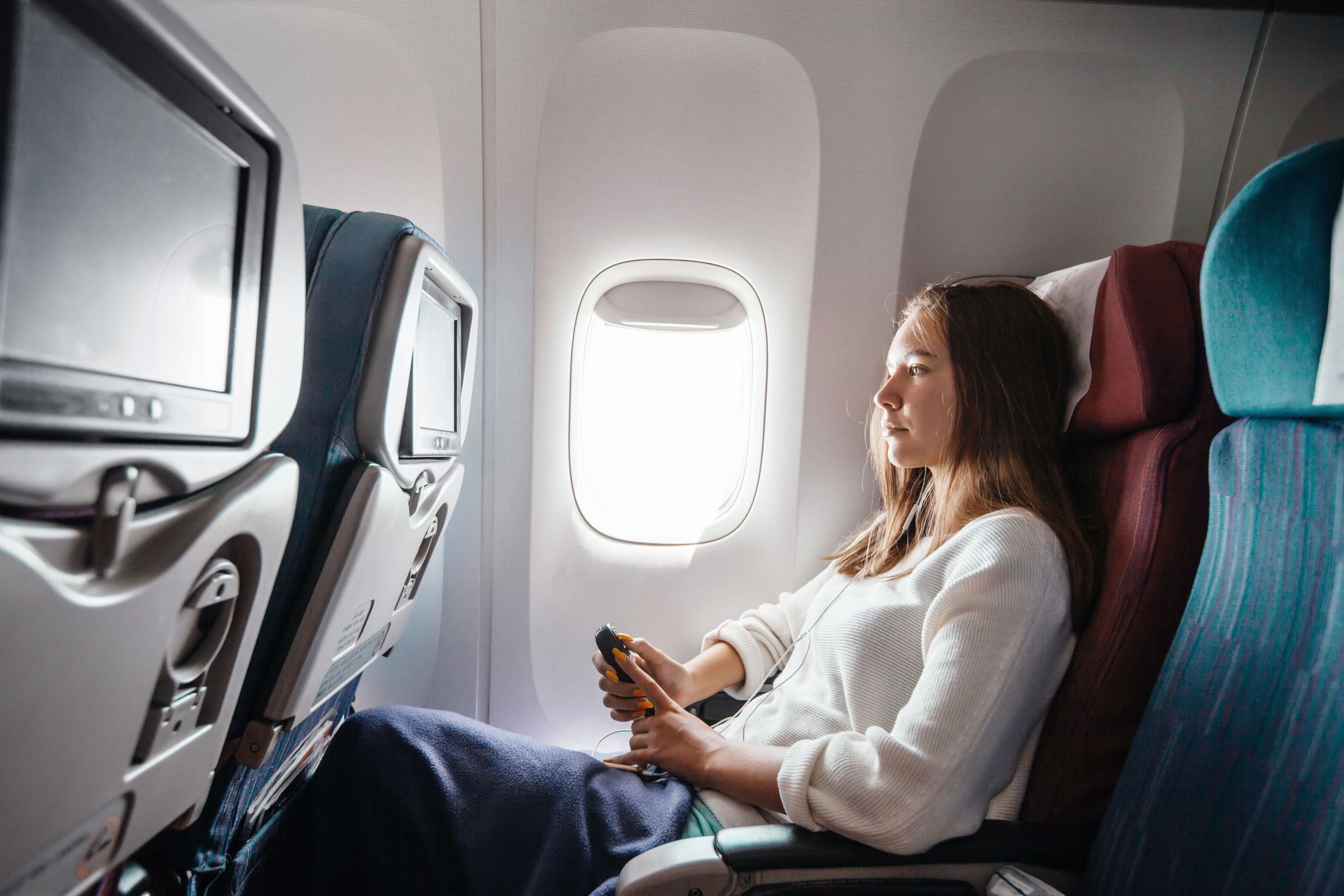 Unexpected Airline Fees Include Pillows, Blankets, Early