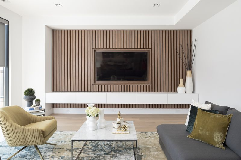 Design Detail A Wood Slat Accent Wall Surrounds The Tv In This Living Room Accent Walls In Living Room White Walls Living Room Living Room Wood #wooden #wall #designs #living #room