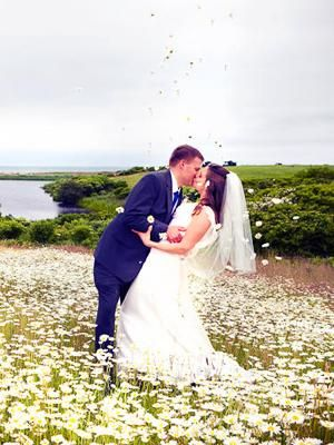 Spring wedding photo idea: In a field of flowers, with flowers raining down | Photo by Callaway Gable