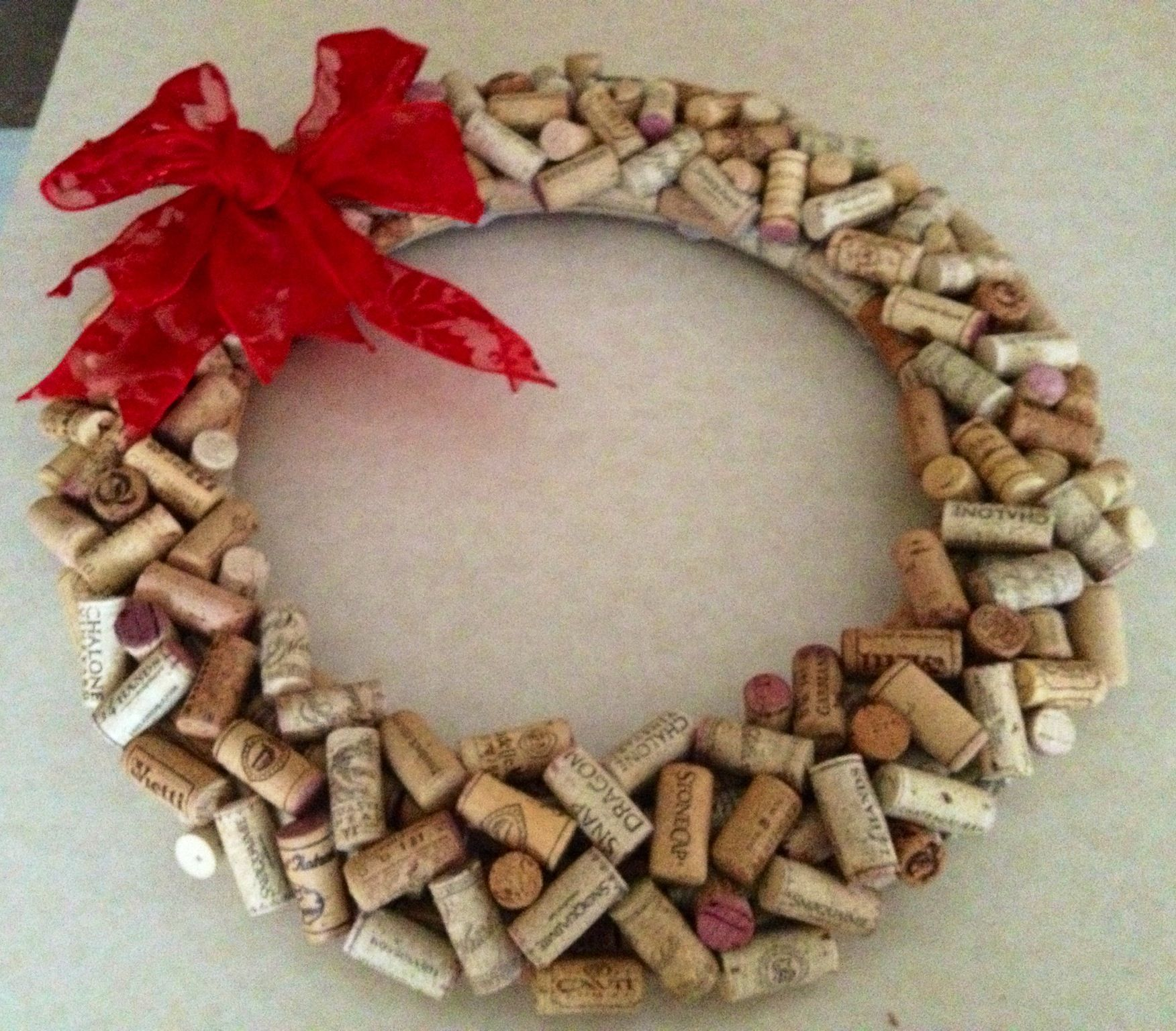 250+ wine corks later...  Wine Cork Wreath. I would love to make this for my grandma!