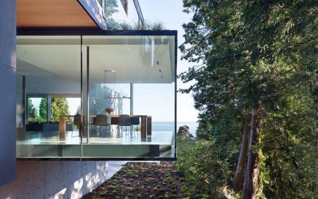 modernes haus steilhang glas box esszimmer aussicht meer - geometrische formen farben modernes haus
