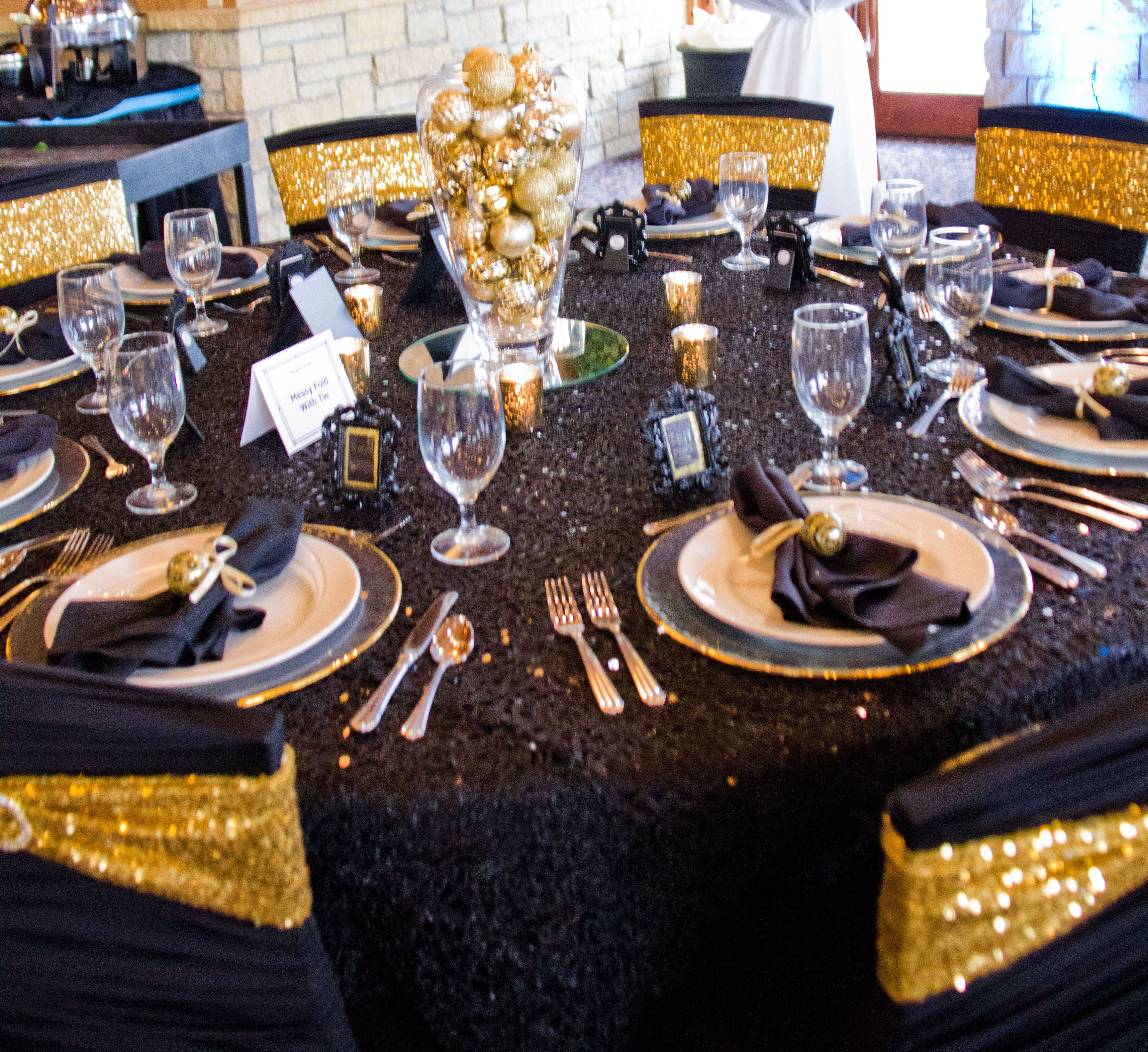 Black Ruched Chair Covers Office Vs Gaming Reddit Cover With Gold Sequin Spandex Sash Chemical Lace Table Overlay Glass Charger Rim And Ornament Centerpiece