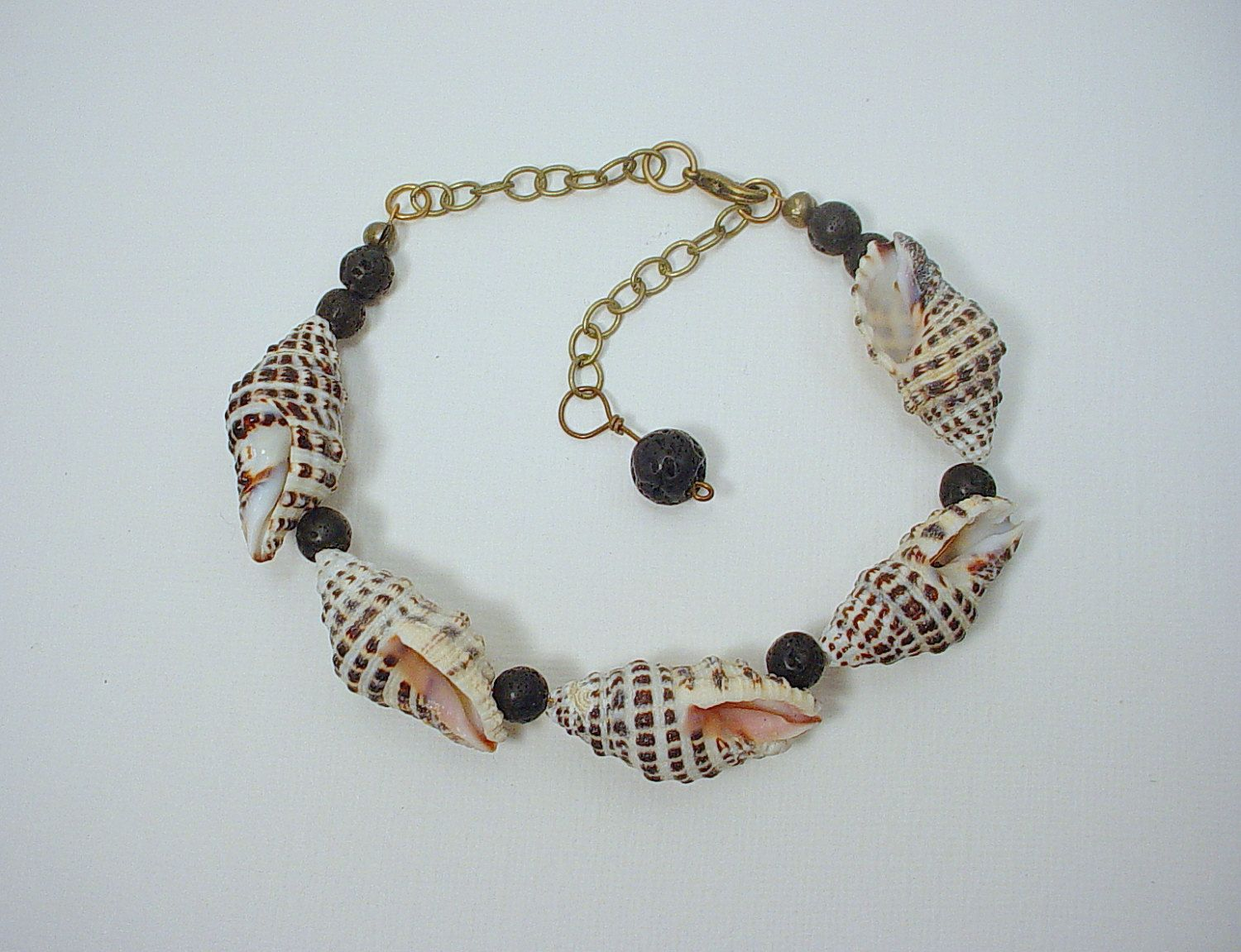 237e13a4fe986 Surfer Dude Bracelet with Black Lava Rock and Small Conch Shells ...