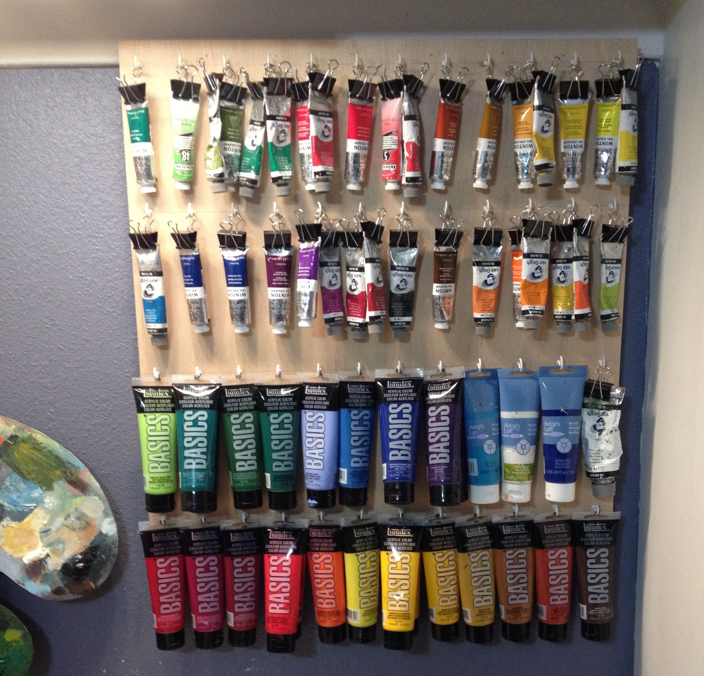 Easy Solution To Store And Display Oil And Acrylic Paints Used 1 4 Plywood With White Cup Hooks And Art Studio Organization Art Studio Room Art Studio Space