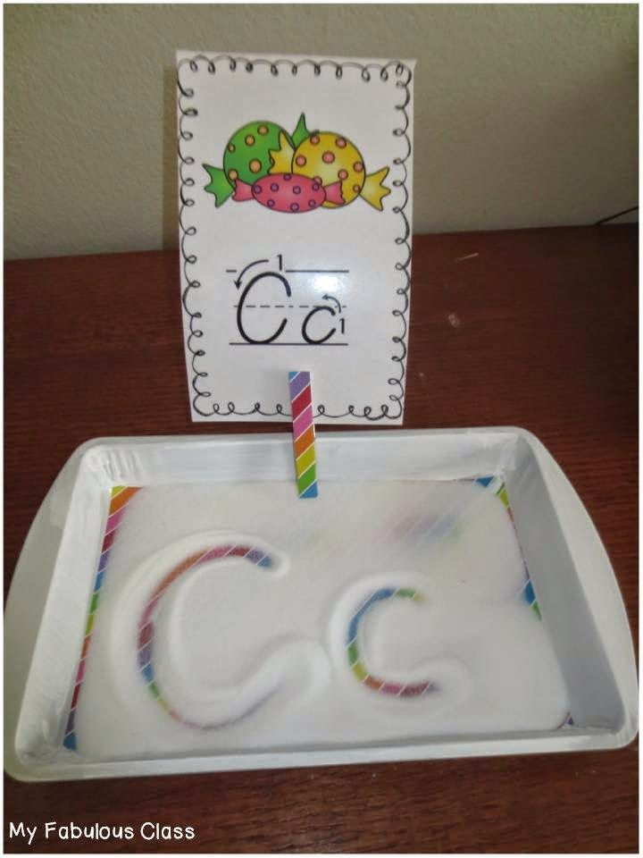 what a fun way to practice letter formationtrace the letter in the salt and see the rainbow underneath it
