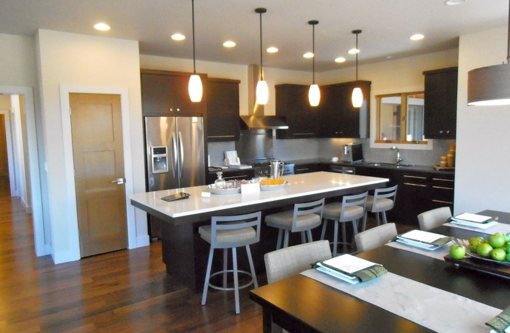 Sleek And Modern Mini Pendant Lights Over Kitchen Island